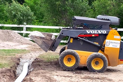 Installing proper drainage on farm land.