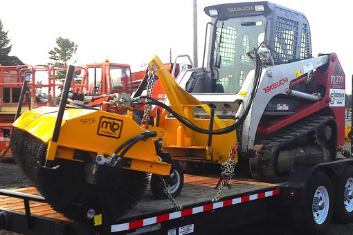 skidsteer with sweeper